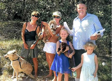 DOG LOVERS: Cr Jason O'Pray and his daughters Lily and Jay Jay with their new dog Muddy and Stephanie Bond and Kate Bazin with Sasha and Molly.