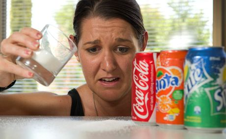 Cancer Council Queensland's Jen Price is startled by the amount of sugar in one can of soft drink. There's about 10 teaspoons in a 375ml can.