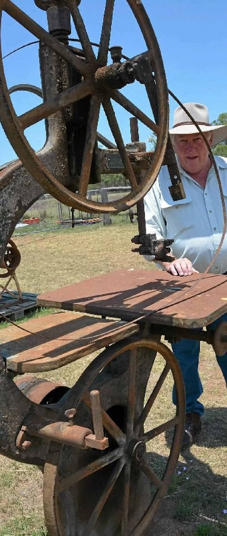 Real estate agent Stuart Bond shows how the old bandsaw would have been used.