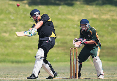 Cameron Neal of Greerton smashes a six in front of Mount Maunganui wicket keeper Tim Clarke during last week's Williams Cup match at Pemberton Park.