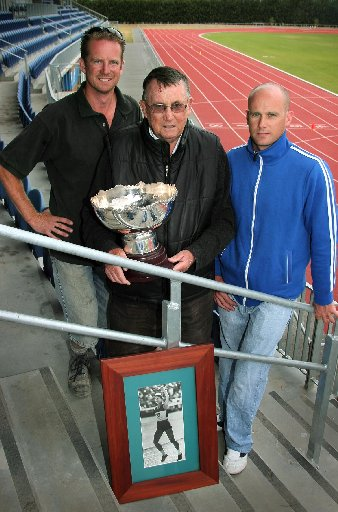 TRACK MEMORIES: Allan Potts, sons Richard (left) and Nicholas with the trophy and a photo of the late Sylvia Potts.