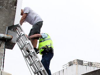 The Fire Service was called to provide a ladder to bring the man down.