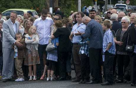 GOODBYES: Family take a last look and bid their final farewell to Featherston supermarket worker Glen Jones, yesterday, as a hearse takes him from the Anzac Hall, where more than 700 mourners had gathered to pay their respects.