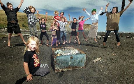 FOUND! Some of the treasure hunt children, including 4-year-old Joe Lammas in front, with the recovered treasure on Kai Iwi Beach. Rebekah Walker is at the back with son Jack.