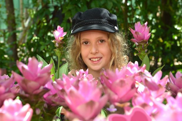 Ginger Flower and Food Festival at The Ginger Factory, Yandina. 10 year old Grace Richardson from Doonan admires the colours of the festival. Photo:Warren Lynam / Sunshine Coast Daily
