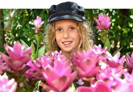FLOWER POWER: 10-year-old Grace Richardson from Doonan admires the colours of the festival.