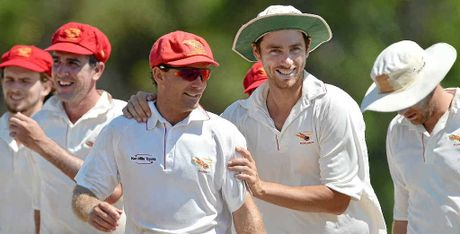 WELL DONE, MATE: The Scorchers' Paul Cash, centre, is congratulated by Peter Dein after a strong bowling performance against Valley last Saturday.