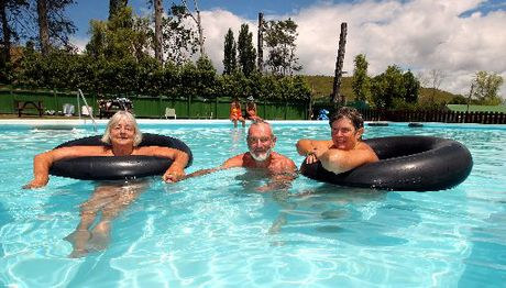 June Mitchell, Alan Mitchell, and Carolyn Ball from the Hawke's Bay Naturist Club enjoy a swim ahead of the club's open day this weekend.