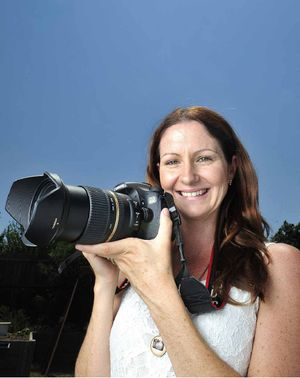 PICTURE PERFECT: Lisa Roper won a competition to have her photograph (right) published on the cover of the Ipswich Yellow Pages.