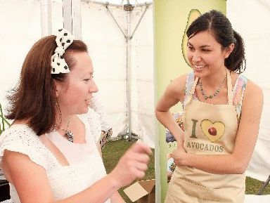 AVOCADO DELIGHTS: 2011 NZ MasterChef winner Nadia Lim (right) talks with Katikati's Carmen Goodwin during a guacamole-making competition at the Katikati Avocado Wine and Food Festival.