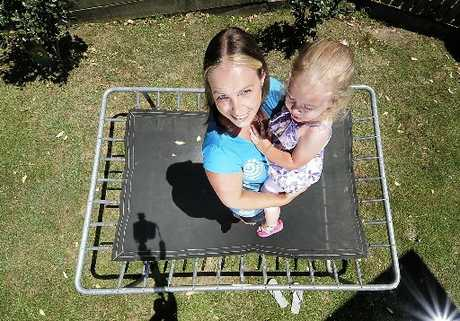 LESSON LEARNED: Trampoline accident victim Sarah Neale and Lexy-Rose, 2, on their trampoline in Welcome Bay.