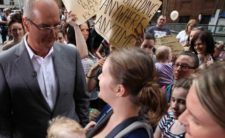 David Koch confronts breastfeeding advocates (centre) Victoria Brookman from Medowbank with Bobby (18 months). (AAP Image/Damian Shaw) 