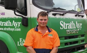 StarthAyr Driver, Trent Stanton delivers the companies turf using an Isuzu FVY 1400 6x4 curtainsider.