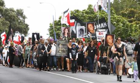 Hundreds of people march down Bank St in Whangarei to raise awareness about domestic violence.