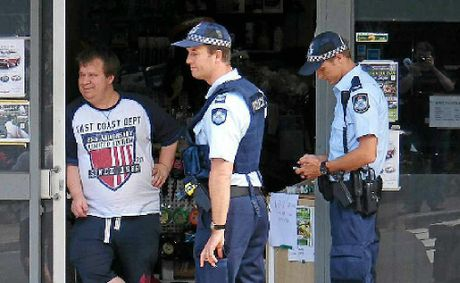 Police talk to Buderim Handyman Hardware store owner Stephen Bardell after an attempted armed robbery.