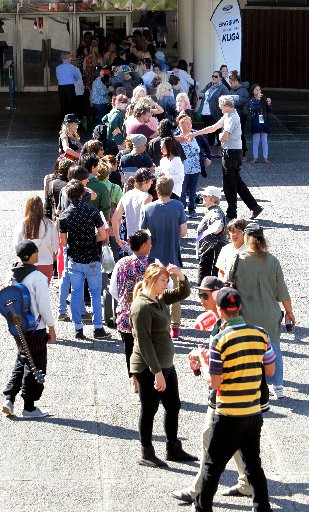 QUEUING UP: The line stretches across the War Memorial Hall forecourt as hopefuls wait to audition for The X Factor. PHOTOS/STUART MUNRO