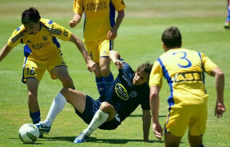 Auckland City FC Albert Riera (centre) clashes with Otago United Aajay Cunningham in the ASB Soccer Premiership match at Kiwitea Street,