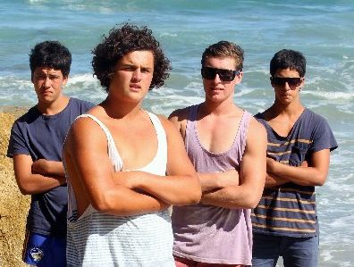 SEA SAVIOURS: Kris Troy (left), 15, Lucan Battison, 14, Nick Roydhouse, 17, and Daniel Troy, 17, along with Callum Willams, 15, Izaiah Lange, 15, and Bailyn Sullivan, 14, (absent), all from Napier, helped rescue three girls from near-death at Waipatiki Beach on Saturday. PHOTO/PAUL TAYLOR HBT123238-03