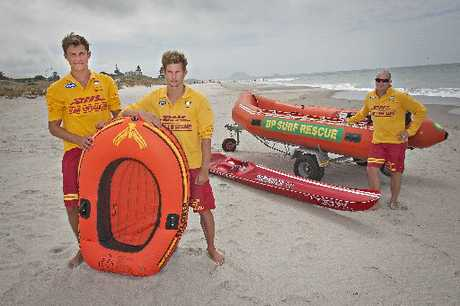 NOT FOR SEA USE: Papamoa Surf Lifesaving Club lifeguards Sam Casey (left) and Hamish Smith were surprised when they were called to rescue two men in a small inflatable boat exactly like the one pictured. Omanu senior lifeguard Allan Mundy (far right) says flimsy water toys should not be used in the sea.