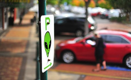 VISITING TOWN? A digitally altered image shows a sign pointing to landing spaces in the CBD.