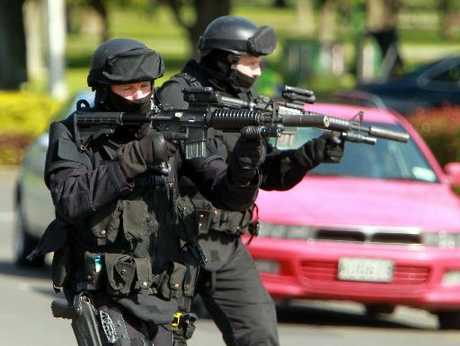 ELITE COPS: Armed offenders squad members in action during the Napier siege.