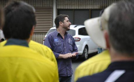 Electrical Trades Union state organiser Trevor Gauld speaks to Ergon Energy workers during a strike last year.
