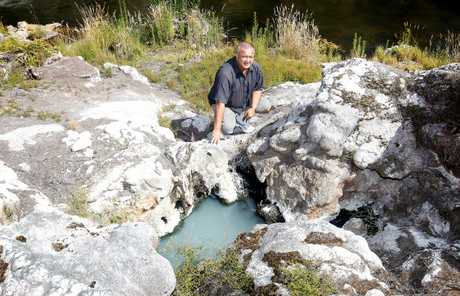 Te Puia's visitor experience general manager, Taparoto Nicholson, next to the recently uncovered now dormant Papakura Geyser, which was active until March 1979.