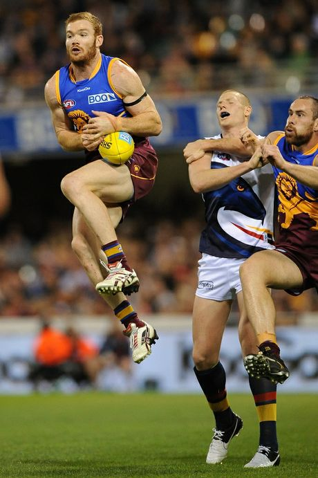 Daniel Merrett of the Lions marks during the round 21 AFL match between the Brisbane Lions and the Adelaide Crows at The Gabba on August 18, 2012 in Brisbane, Australia.