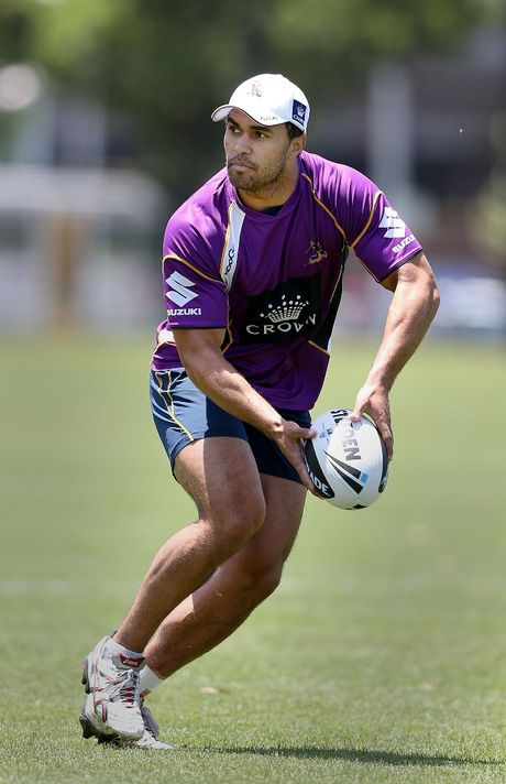Justin O'Neill looks to pass the ball during a Melbourne Storm NRL training session at Gosch's Paddock on December 10, 2012 in Melbourne, Australia.