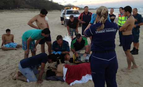 ONE man has been taken to hospital after him and five others were pulled from the surf at Marcoola.