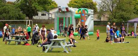 Picnic atmosphere for relaxing and bouncy castle loaned by Gracelands for fun for the kids.