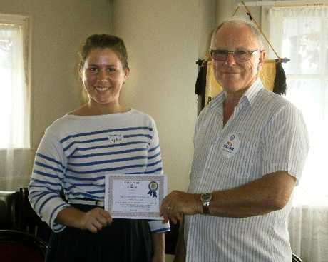 Rotary Club president Peter Robertson presents a Rotary Certificate of Achievement to Sophia Hunt.