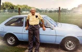 Hugh Pickering stands by his 1977 Mazda - which was stolen from his garage. A Facebook campaign is trying to get the car returned to its rightful owner.