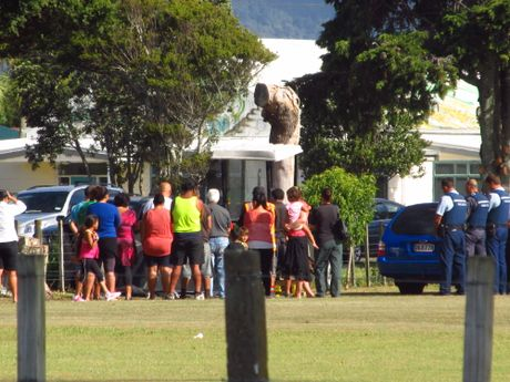 GATHER: A group of people gather around a tractor at Opotiki College where a local man was killed after getting caught in machinery of mowing equipment at the school.
