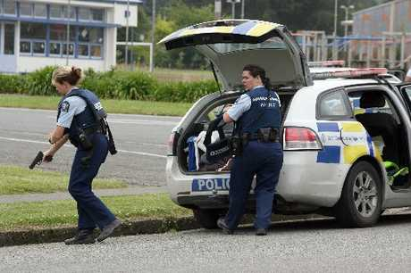 ON ALERT: Armed police outside a Featherston school after a gun scare in 2011.