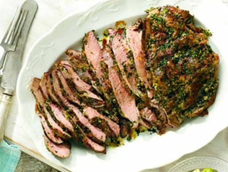 Barbecued butterflied lamb leg seasoned with parsley, capers and lemon.