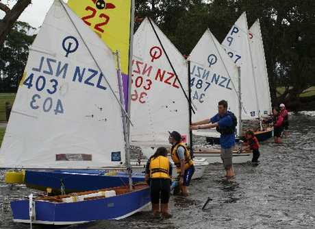 BOAT RETRIEVAL: Course co-ordinator Dave Smith (centre) assists young sailors get their yachts back on dry land