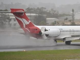 Facebook liker Jamie Chinery's photo of QantasLink's Boeing 717 landing in heavy rain in Gladstone on January 24, 2013.