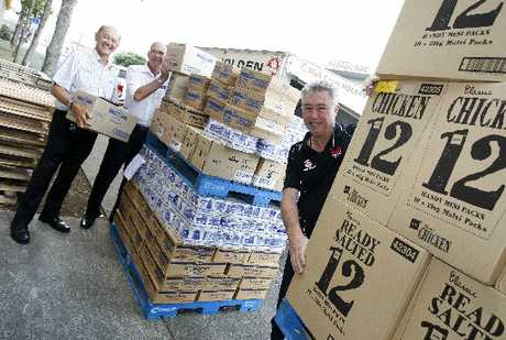 FOOD GALORE: Rodney Chang, Pete Mullenger and Mark Cromie with the $4000 worth of food donated from Mark Cromie Holden.