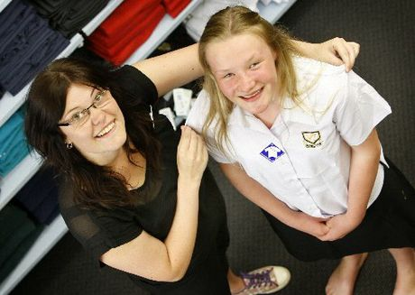 MEASURING UP: Keshia Nicolson of Bethells Uniform fits Claudia Cooke for her first Whangarei Girls' High School uniform.