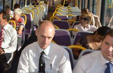 Sunshine Coast politicians mix with commuters on yesterday's 6.14am train from Nambour to Brisbane.