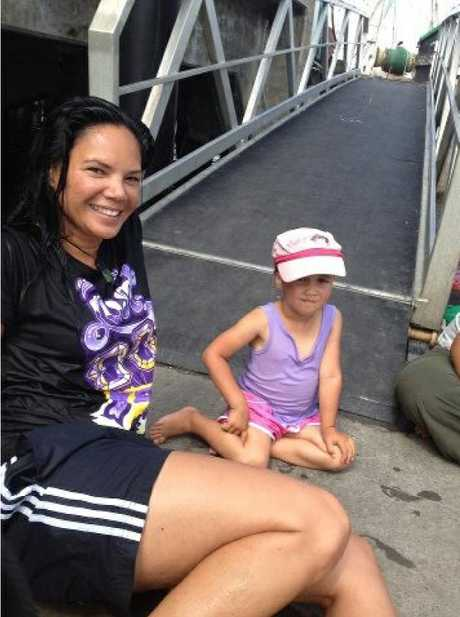"SAVIOUR: Paulette Lewis and the little girl she saved at Mangonui on Sunday - ""You do what you have to do."""