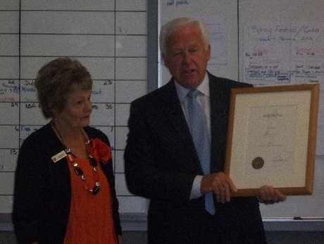HONOUR: Woolf Fisher Trust secretary Dr Nigel Evans presents Judy Dixon with her award.
