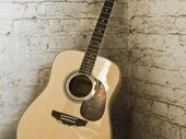 A MAN was bashed with his own acoustic guitars in a home invasion in Sydney overnight.