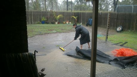 Clearing the drain at a property on Yellowpatch Avenue, Clinton in Gladstone.