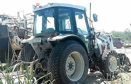 Police are seeking public help in recovering this tractor, stolen from the Cooroy to Curra construction site.
