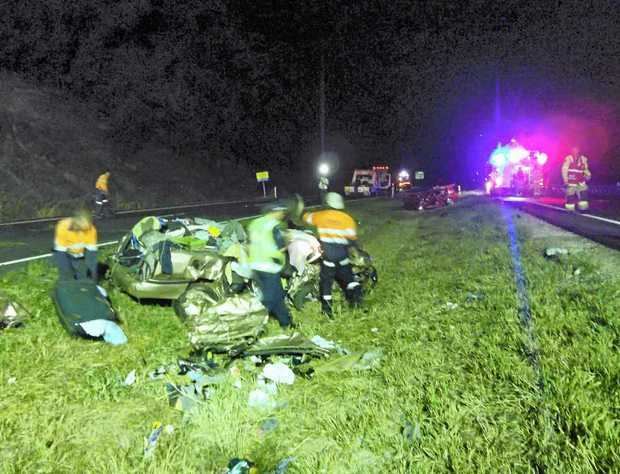 LIVES WRECKED: The scene of the three-vehicle crash on the Bruce Hwy at Kulangoor.