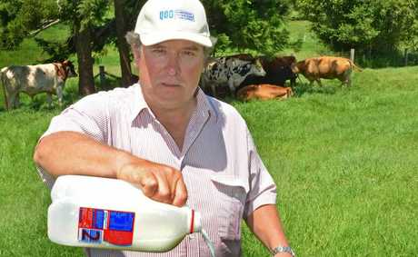 Queensland Dairyfarmers' Organisation president Brian Tessmann says dairy farmers are still struggling two years on from Coles introducing $1/litre milk into its supermarkets.
