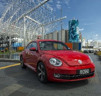 The 2013 Beetle's profile recalls the lines of its Porsche great-great uncles.