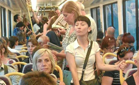 Commuters on a Brisbane to Sunshine Coast train on Wednesday.